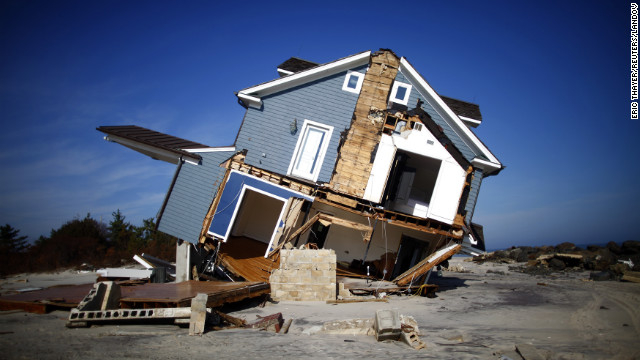 Image #: 20098975    A home that was damaged by Hurricane Sandy is seen in Mantoloking, New Jersey November 12, 2012. REUTERS/Eric Thayer (UNITED STATES - Tags: DISASTER ENVIRONMENT)       REUTERS /ERIC THAYER /LANDOV