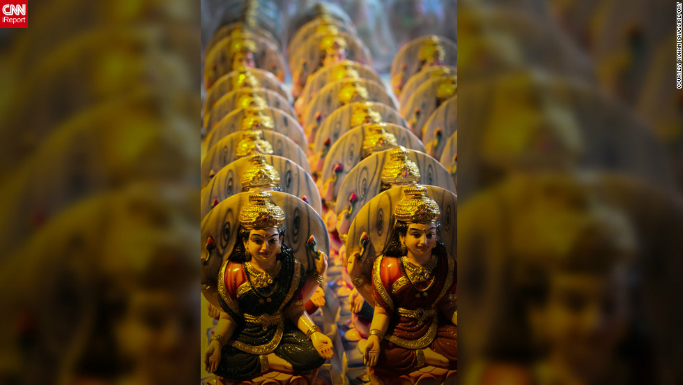 "This picture was captured by iReporter <a href=""http://ireport.cnn.com/docs/DOC-880798"">Rohan Pavgi</a> and displays miniature-statues of the Goddess Lakshmi for sale in a market in Pune, India. He says the neat manner in which the statues are aligned emphasizes an important part of Hindu beliefs and tradition.""[Lakshmi] is worshiped by those who wish to acquire or to preserve wealth. It is believed that (wealth) goes only to those houses which are clean and where the people are hardworking,"" he says. ""She does not visit the places which are dirty or where the people are lazy."""