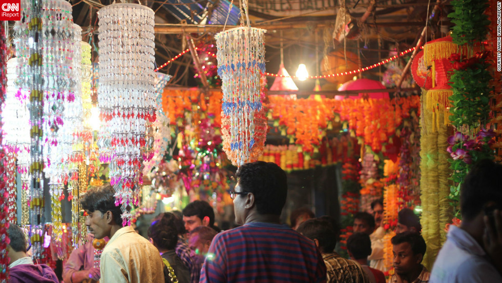 "<a href="" http://ireport.cnn.com/people/manishkanoji"">Manish Kanojia</a> took this photograph whilst shopping at the Sadar Bazar in Delhi, one of the busiest wholesale markets in India. According to Kanojia it is famous for Diwali shopping. He says the day he captured the image ""the markets were crowded [and] people were happily shopping around for gifts and decoration stuff."""