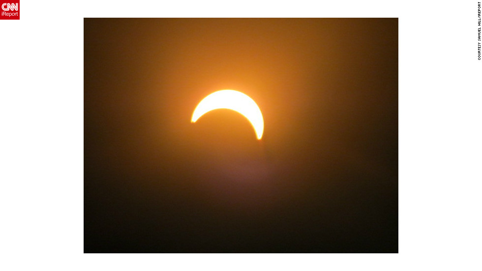 """I thought it would be cool to take a few photos because I haven't seen an eclipse in my lifetime, says iReporter <a href=""http://ireport.cnn.com/people/sjhill87"">Samuel Hill</a> who shot this picture in Wellington, New Zealand. ""Most people were really excited once they got to look through the solar lenses to see the eclipse."""