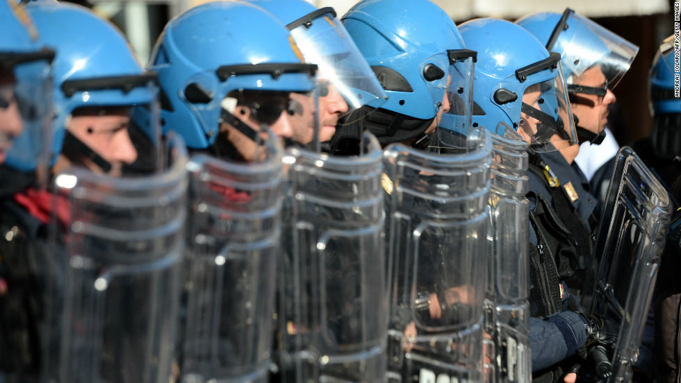 Riot policemen stand in line in Rome.