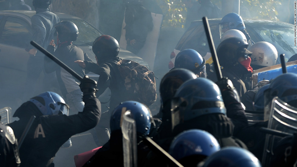 Riot policemen fight demonstrators in Rome.