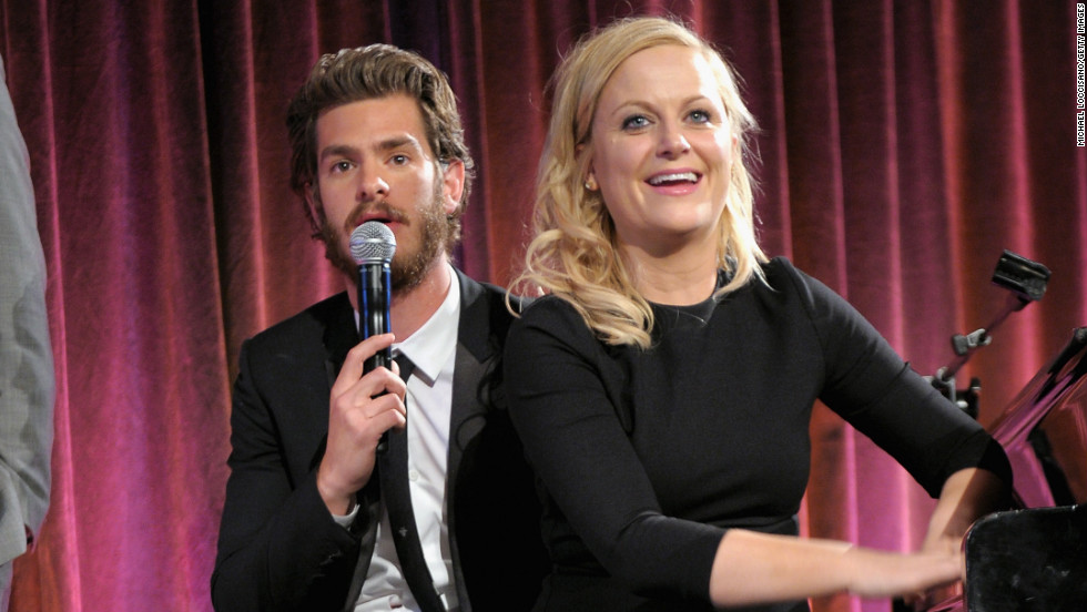 Andrew Garfield and Amy Poehler share a seat at a benefit in New York City.