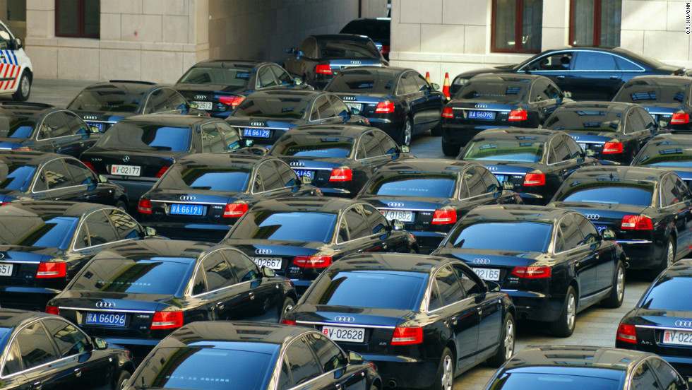 Cars for delegates to the party congress are pictured near the Great Hall of the People, mostly black  Audis.