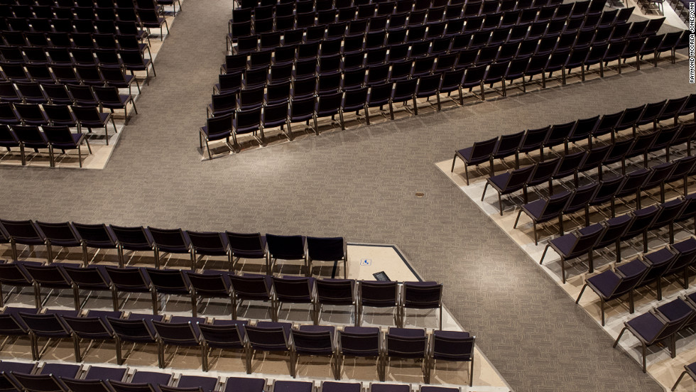 Chairs fill the large main sanctuary at North Point Community Church, where Andy Stanley is the senior pastor. The church helped pioneer a new way of worshipping that used contemporary Christian music, stage lights, video skits and visual props during sermons.