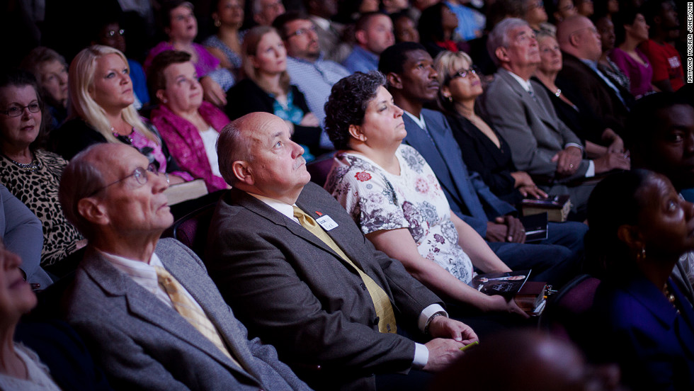 The congregation at First Baptist Church Atlanta is transfixed as they watch a video presentation of Charles Stanley's life. Stanley was twice elected president of the Southern Baptist Convention. He groomed his son, Andy, to be his heir apparent but a rift developed between the two. The two have since reconciled.