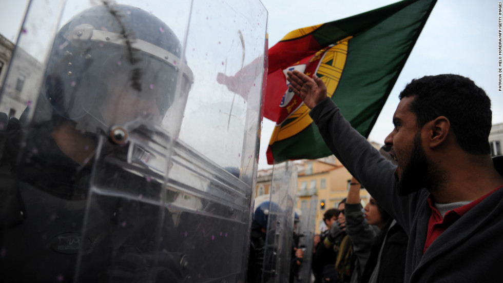Riot police face protesters outside the Portuguese parliament Wednesday in Lisbon.