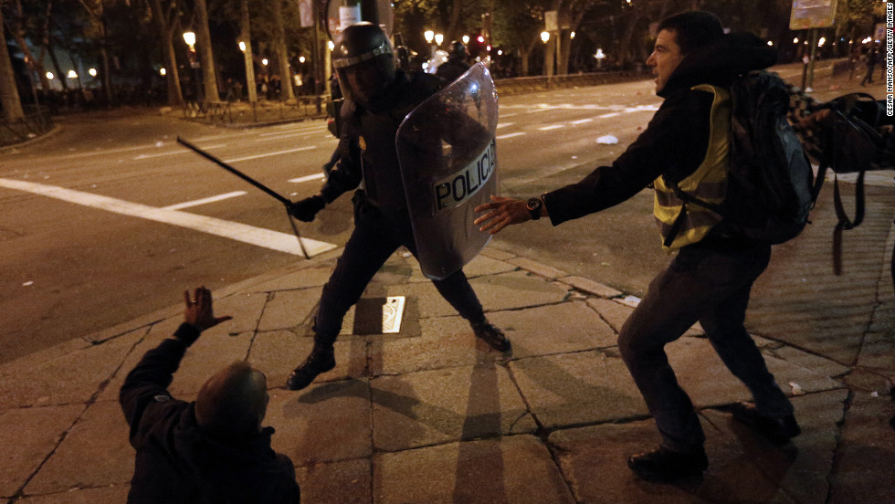 A police officer clashes with protesters Wednesday in Madrid. Spain is experiencing its second general strike in a year, and some of Europe's largest and occasionally violent protests took place there.