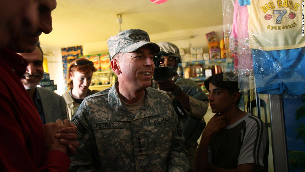 Petraeus speaks with store owners in the Ghazaliya neighborhood in Baghdad in August 2007.
