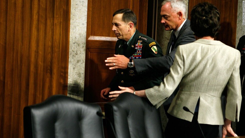 Petraeus apparently faints while testifying during a hearing before the Senate Armed Services Committee in June 2010 in Washington. Pictured, he is escorted away after the incident.