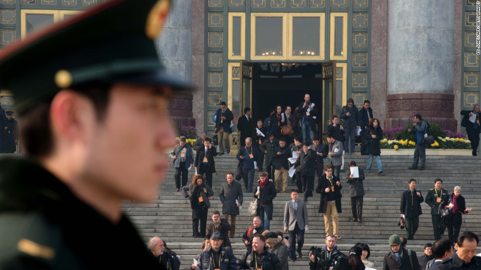 A paramilitary guard stands outside the Great Hall of the People as journalists leave the unveiling ceremony of a new Politburo Standing Committee on November 15.