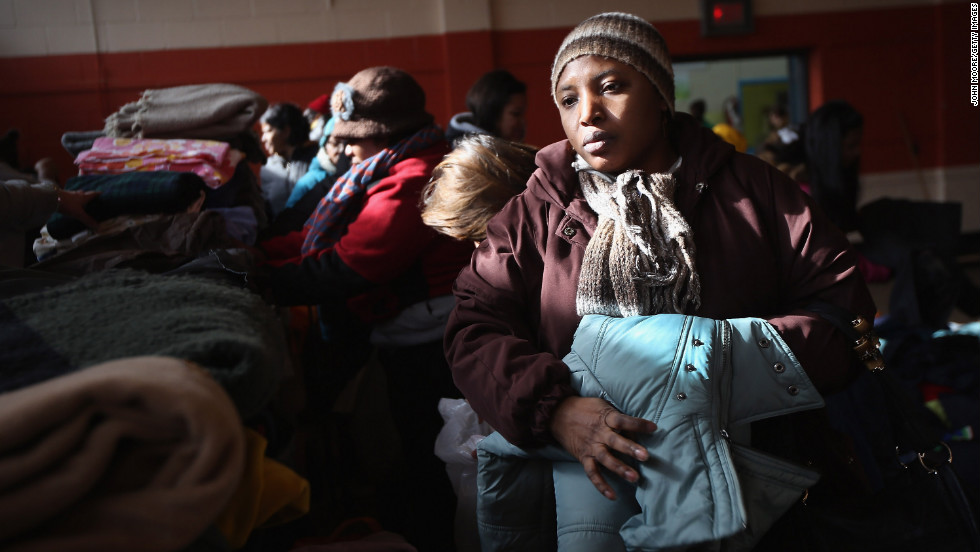 Residents take free clothing Thursday at the Ocean Bay Action Center in Queens.