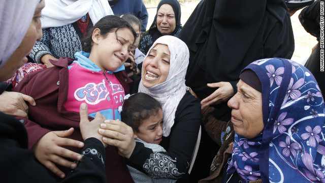 Palestinian women and children cry during the funeral of Audi Naser in Beit Hanun on Friday.