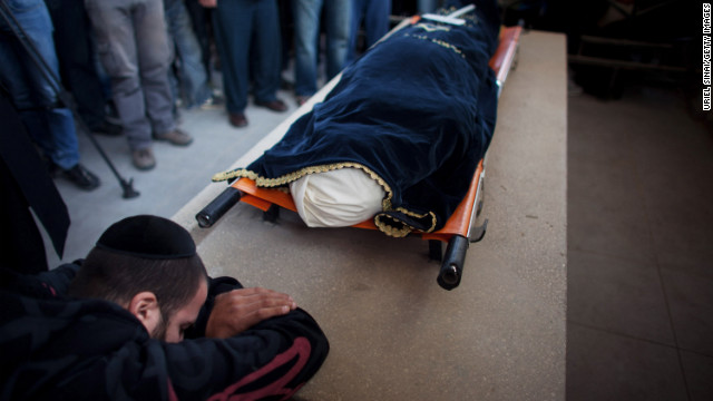 A relative grieves during the funeral for Itzik Amsalem, 49, in Kiryat Malachi, Israel on Friday, November 16.