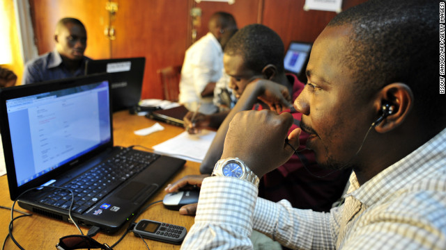 Observers for Sierra Leone's National Election Watch check computers in Freetown, November 16, 2012, ahead of elections.