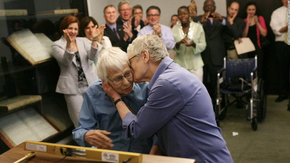 Phyllis Siegel, right, kisses her wife, Connie Kopelov, after exchanging vows at the Manhattan City Clerk's office on July 24, 2011, the first day New York's Marriage Equality Act went into effect.