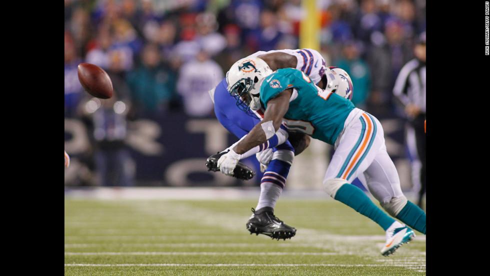 Miami's Reshad Jones, right, knocks the ball free from Donald Jones of the Buffalo Bills.