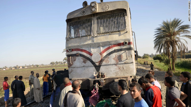 Egyptians inspect the damage caused by train accident in the province of Assuit, south of Cairo on November 17.