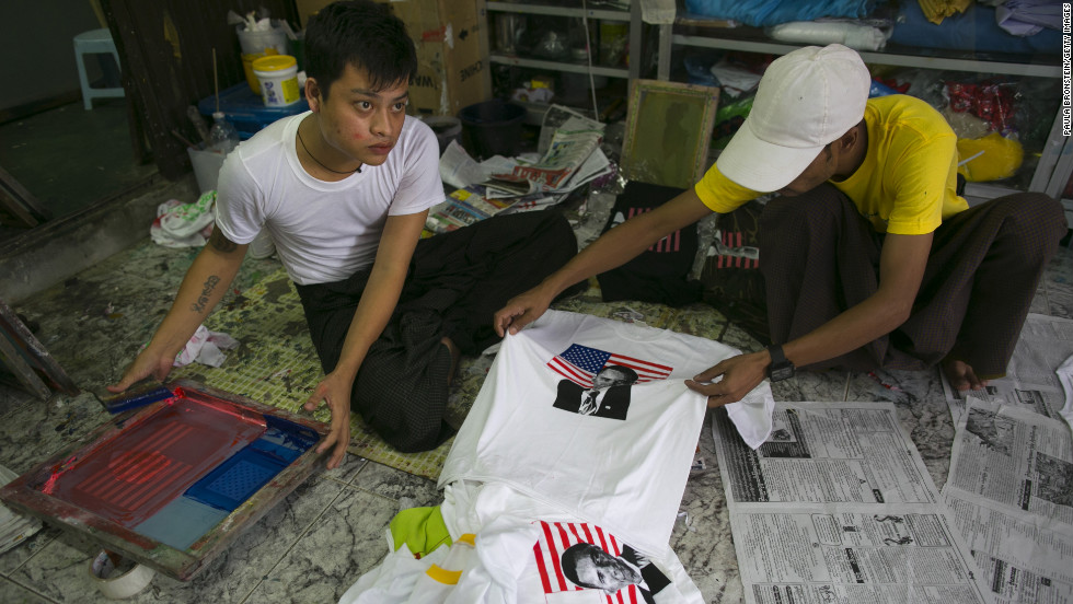 Two men silk-screen Obama T-shirts at a shop in Yangon on Sunday in preparation for Obama's visit.
