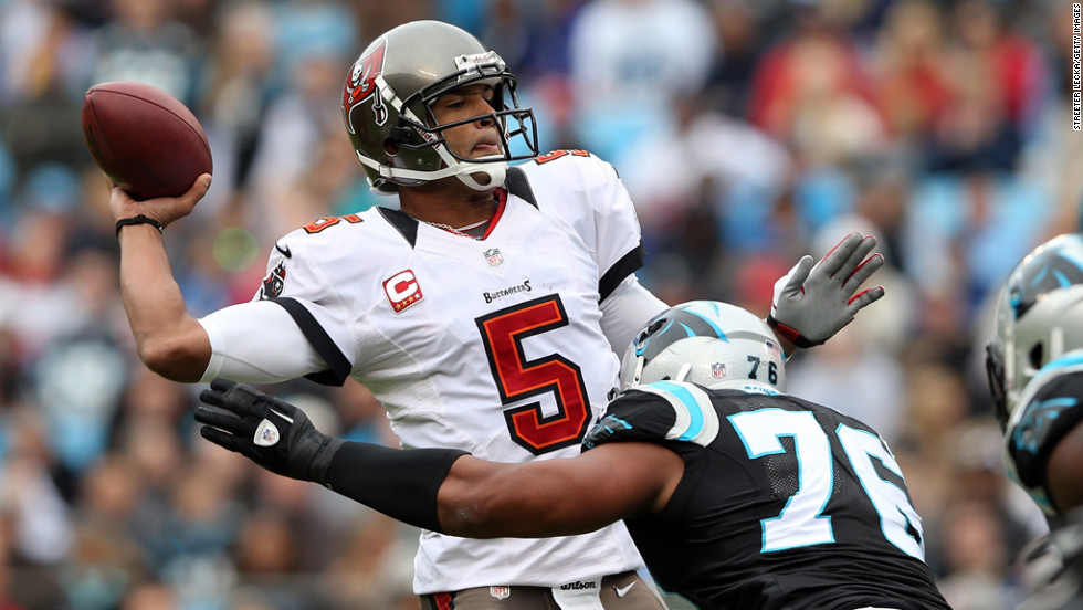 Greg Hardy of the Panthers hits Josh Freeman of the Buccaneers as he throws a pass on Sunday.