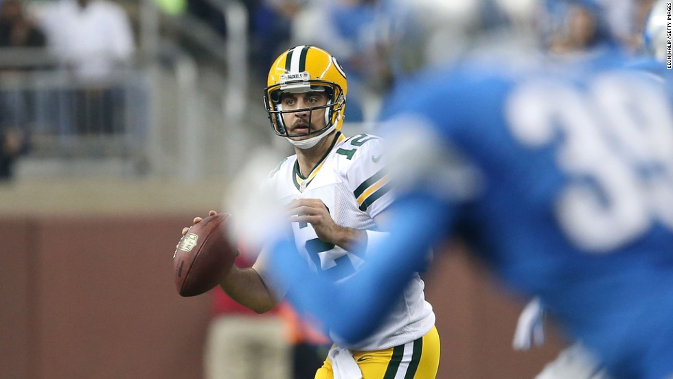 Aaron Rodgers of the Green Bay Packers rolls out to pass during the first quarter of the game against the Detroit Lions at Ford Field on Sunday in Detroit.