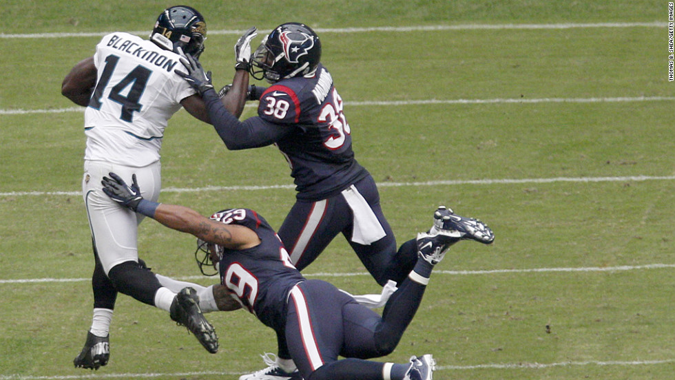 Justin Blackmon of the Jaguars tries to fend off No. 38 Danieal Manning of the Texans and No. 29 Glover Quin of the Texans on Sunday.