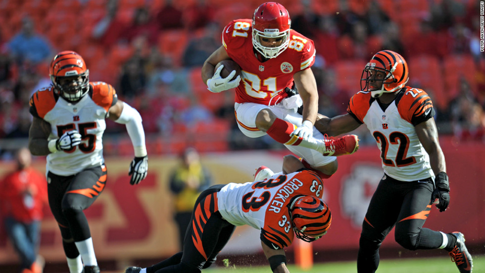 Tight end Tony Moeaki of the of the Chiefs leaps over defenders No. 33 Chris Crocker and No. 22 Nate Clements of the Bengals in route to a first down during the first half on Sunday.