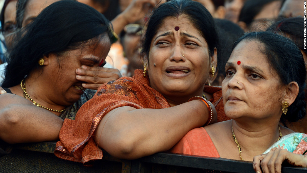 Women weep during the funeral of Bal Thackeray.