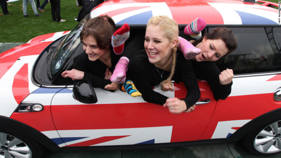 Linsi Ludlam, from left, Helen Statnic and Katie Fitzpatrick are part of the 28-member team from the UK who dared to set a world record for how many people can fit in a modern Mini hatchback -- which they did.