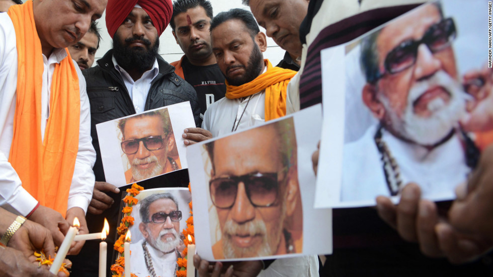 Members of the Indian Hindu nationalist Shiv Sena party light candles as they pay tribute to party founder and chief, Bal Thackeray in Amritsar on Sunday.