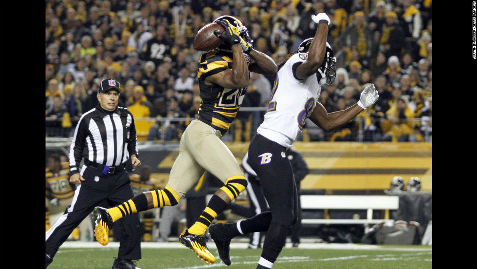 Ike Taylor of the Pittsburgh Steelers breaks up a pass intended for Torrey Smith of the Baltimore Ravens.