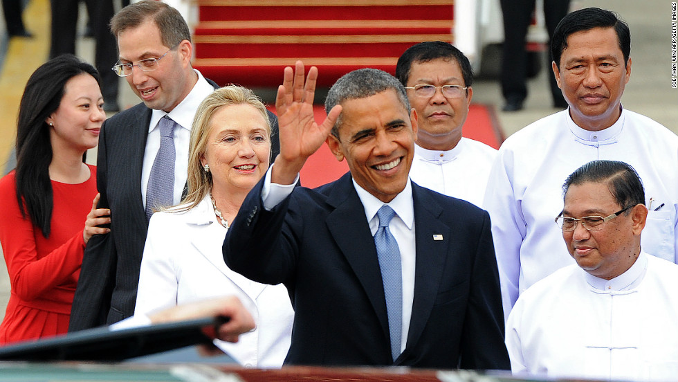 U.S. President Obama waves after stepping off his flight.