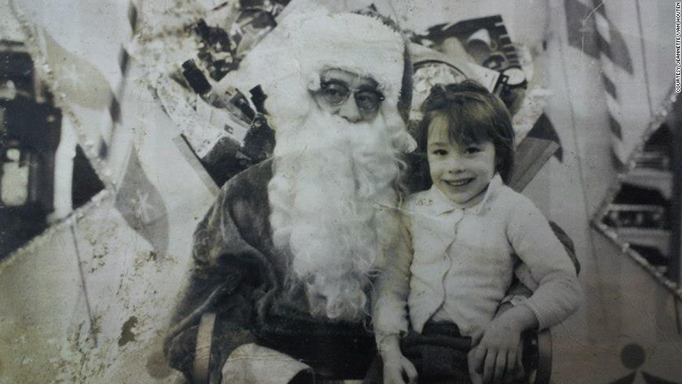 A child sits on Santa's lap in this damaged photograph, found in Union Beach after Sandy swept through.