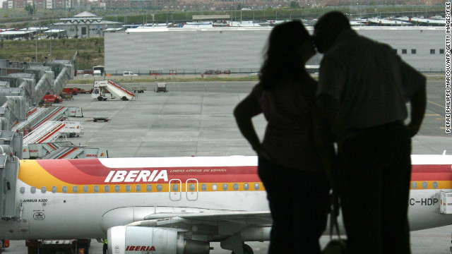 A couple kiss at Barajas airport in Madrid.