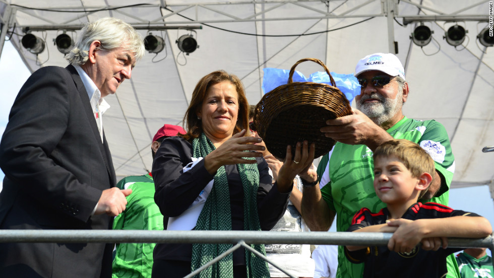 Mexican tycoon Slim is pictured at the 2012 Homeless World Cup in October. His widespread interests include providing financial backing for Mexican Formula One driver Sergio Perez.