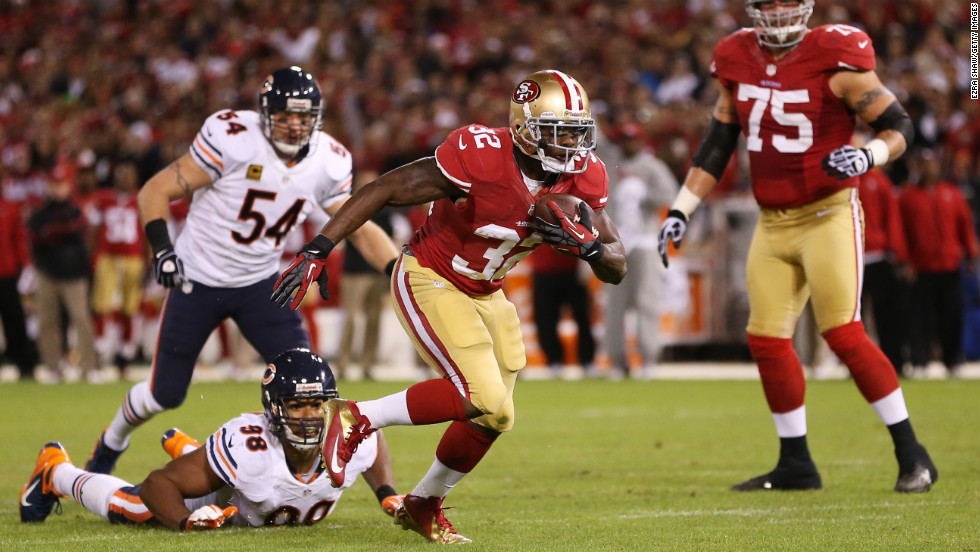 """Kendall Hunter of the San Francisco 49ers breaks away from Chicago Bears defenders for a second quarter touchdown on Monday, November 19, at Candlestick Park in San Francisco. Check out the action from Week 11 of the NFL and <a href=""""http://www.cnn.com/2012/11/08/football/gallery/nfl-week-10/index.html"""">look back at the best photos from Week 10</a>."""