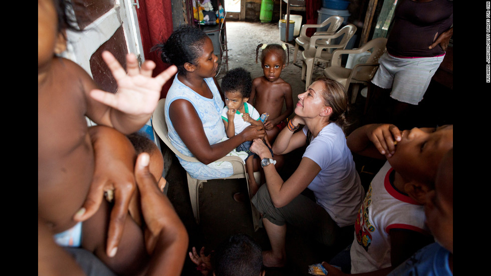 """""""(Escobar) took us to the poor communities where she does outreach to young mothers,"""" photographer Krisanne Johnson said. """"I immediately noticed her passion, her dedication and empathy toward the plight of these teen mothers, who struggle in very harsh conditions to makes ends meet and to keep their children healthy."""""""