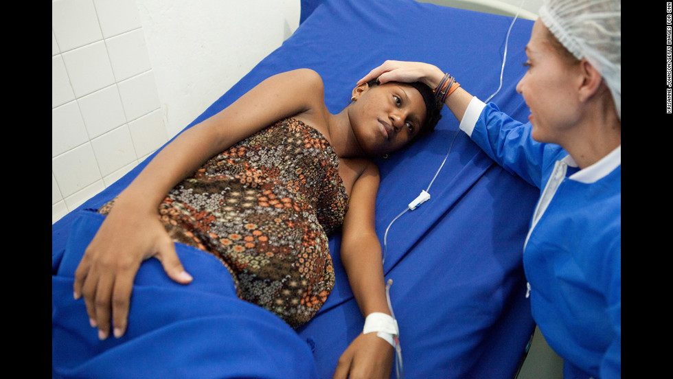 Escobar comforts a woman in labor at a maternity clinic she established in Cartagena. Escobar said she started her foundation after seeing too many babies die from preventable causes.