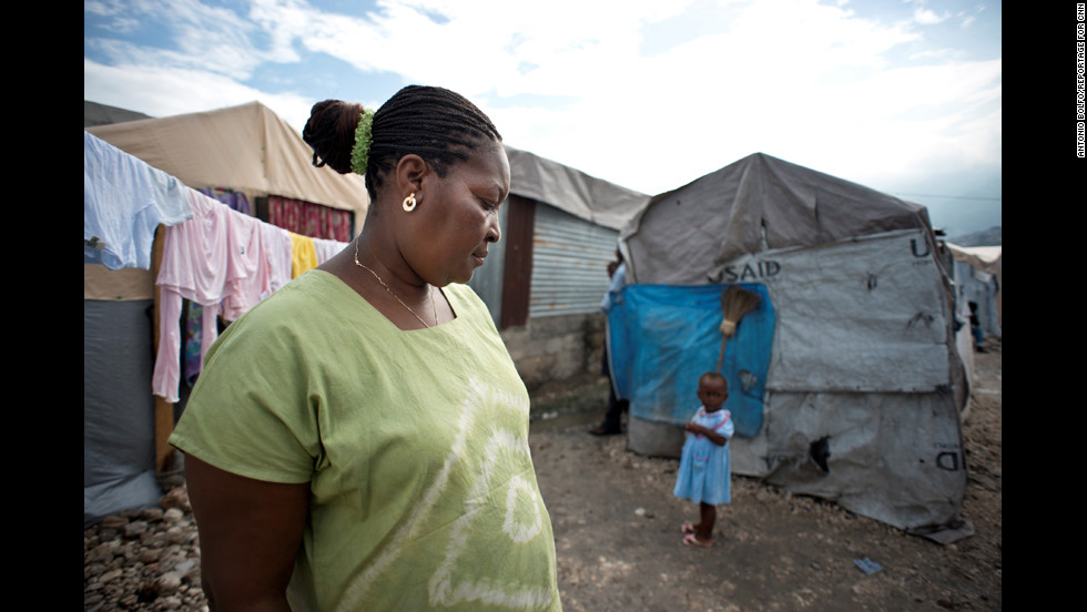 Villard-Appolon walks through the tent camp where she used to live in Port-au-Prince. After the earthquake, camps were set up to provide shelter for more than a million displaced Haitians. But because of a lack of security in these tent cities, many women have been victims of assault, Villard-Appolon said.