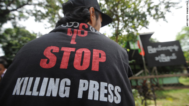 "Prior to August 20, reporters could often be found wearing political T-shirts that said ""Stop killing press."""