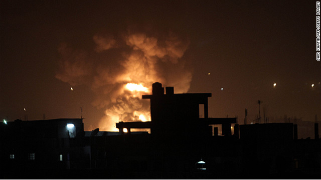 Fire rises during an explosion following an Israeli strike on the border tunnels between Egypt and Rafah in the southern Gaza Strip on November 20, 2012. US Secretary of State Hillary Clinton vowed to support Israeli security on November 20  while calling for a quick de-escalation of Gaza fighting that stretched on unabated amid signs of an emerging truce deal.