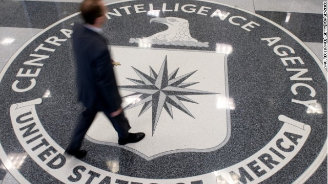 A man crosses the CIA logo in the lobby of the agency's headquarters in Langley, Virginia.