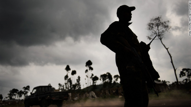 An M23 rebel stands guard in the village of Kanyarucinya, in eastern Democratic Republic of the Congo, on November 18, 2012.