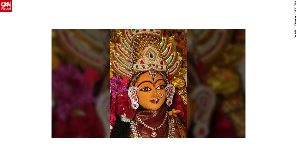 "<a href=""http://ireport.cnn.com/docs/DOC-883257"" target=""_blank"">Sobhana Venkatesan</a> lives in St. John's, Newfoundland, Canada. The photo depicts an ""Amman Alankaram "" of Goddess Lakshmi. It was made by covering sandalwood paste on a dehusked coconut shell before Lakshmi's facial features were painted in. ""Prayers offered to Goddess of Wealth, Lakshmi, during Diwali celebrations beckons prosperity into our homes and lives,"" says the 52-year-old."