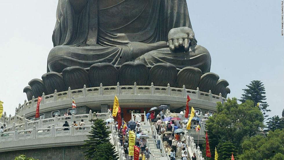 Worshippers gather at the giant Buddha at Po Lin Monastery on Lantau Island near Hong Kong.