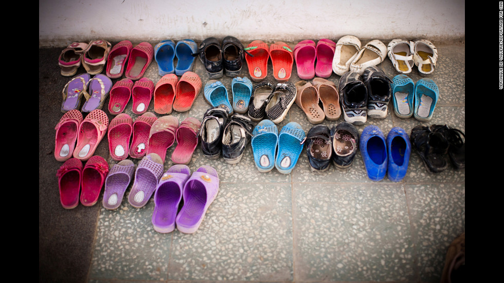The girls have to take off their shoes before entering their classroom.