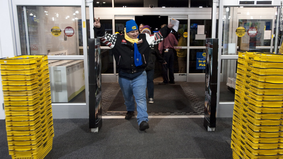 Gordon Kelly raises his arms as he crosses the threshold of the Best Buy in Eden Prarie, Minnesota on November 25, 2011 -- the store's earliest Black Friday shopper.