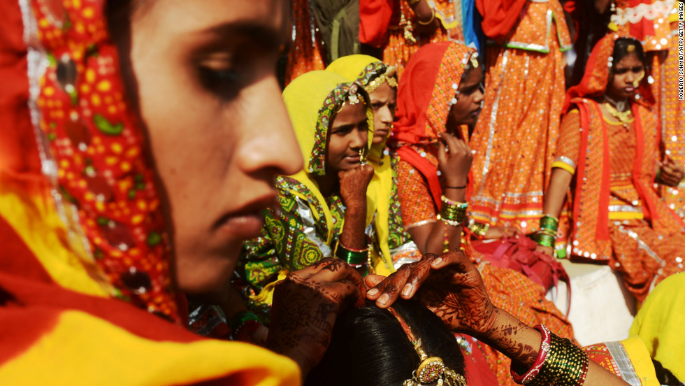 Indian women gather for the start of a traditional dance presentation at the camel fairgrounds in the outskirts of Pushkar.