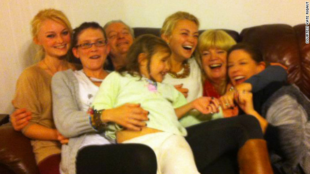 Family and friends pile on the couch at the so-called 'Douglas Family Compound.'
