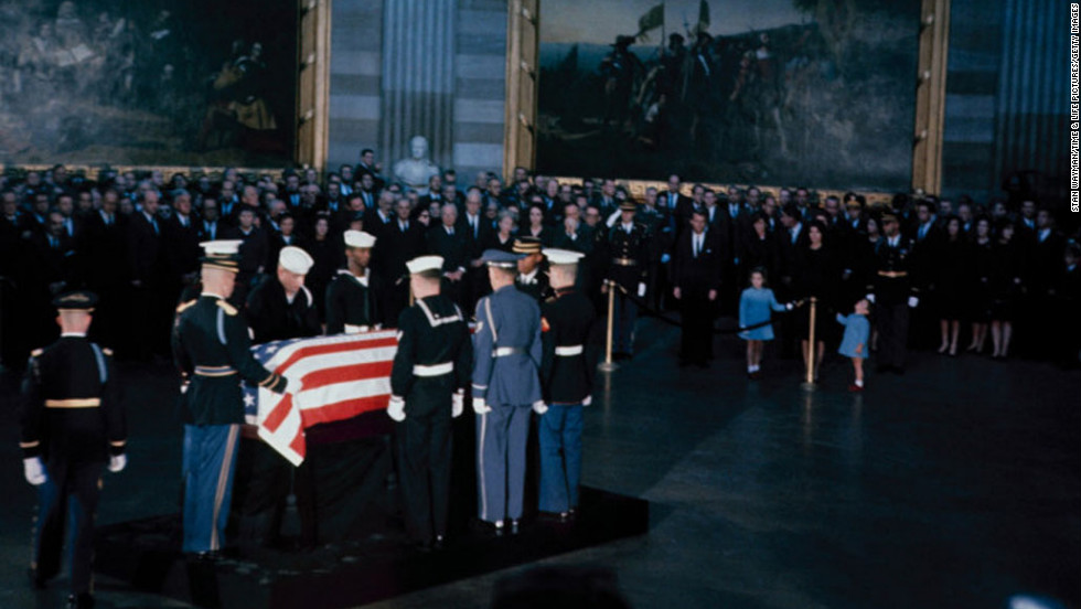 Kennedy's flag-draped casket lies in state in Washington.